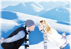 Happy couple playing outdoor at winter mountains Stock Photo