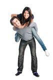 Happy couple playing piggyback together Stock Photography