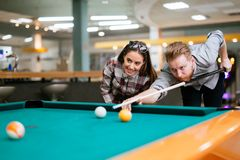 Beautiful couple playing billiards Royalty Free Stock Photo