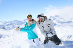 Happy couple playing with snow royalty free stock photos