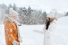 Happy couple playing with snow in winter Stock Photography