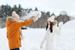 Happy couple playing with snow in winter Stock Photos