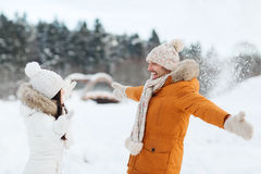 Happy couple playing with snow in winter Royalty Free Stock Image