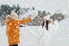 Happy couple playing with snow in winter Stock Images