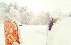 Happy couple playing with snow in winter Stock Photo