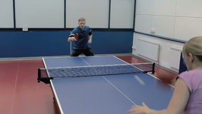 Happy couple playing the table tennis at the court stock footage