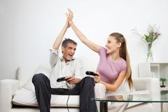 Happy Couple Playing Video Game At Home Royalty Free Stock Images
