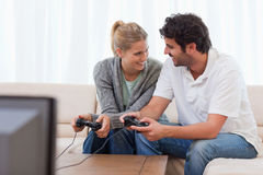 Happy couple playing video games Stock Photography