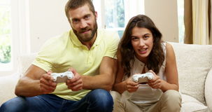 Happy couple playing video games stock video