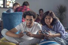 Happy couple playing video games at the modern startup office royalty free stock photography