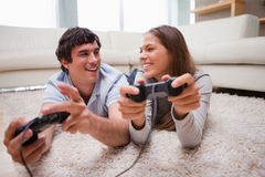 Happy couple playing video games together. Happy young couple playing video games together Royalty Free Stock Image