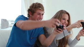 Happy couple playing video games together Stock Photo