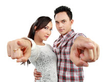 Happy couple pointing Royalty Free Stock Photos