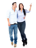 Happy couple pointing away Royalty Free Stock Photography