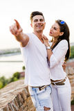 Happy couple pointing in a direction Royalty Free Stock Photography