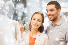 Happy couple pointing finger to shop window Stock Photography