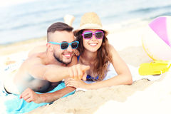 Happy couple pointing at something at the beach. A picture of a happy couple pointing at something at the beach Royalty Free Stock Photography