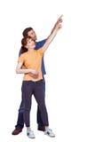 Happy couple pointing upwards together Stock Image