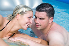 Happy couple in a pool Stock Images