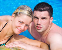 Happy couple in a pool Stock Photography