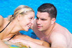 Happy couple in a pool Royalty Free Stock Photography