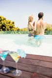 Happy couple in the pool Royalty Free Stock Image