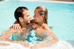 Happy couple in the pool. Looking at each other Stock Photo