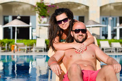 Happy  couple    on a pool Stock Photography