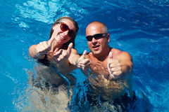 Happy couple in pool Stock Images