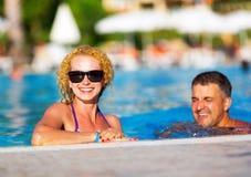 Happy couple in the pool Stock Photo