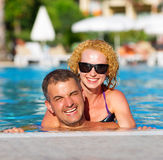 Happy couple in the pool Royalty Free Stock Photo