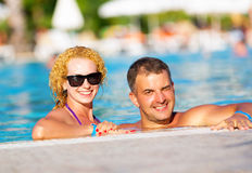Happy couple in the pool Stock Image