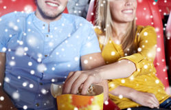 Happy couple with popcorn in movie theater Stock Photo