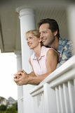 Happy Couple on Porch of Home Stock Photo