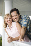 Happy Couple on Porch of Home Stock Photography