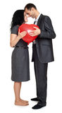 Happy couple portrait with red heart shaped balloon. Valentine holiday concept. Studio isolated. Happy couple portrait with red heart shaped balloon. Valentine Stock Images