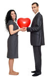 Happy couple portrait with red heart shaped balloon. Valentine holiday concept. Studio isolated. Happy couple portrait with red heart shaped balloon. Valentine Royalty Free Stock Photography