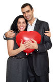 Happy couple portrait with red heart shaped balloon. Valentine holiday concept. Studio isolated Stock Photos