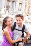 Happy couple portrait, Trevi Fountain, Rome, Italy. Smiling young couple traveling together on romantic travel vacation holiday in Europe. Asian woman stock photo