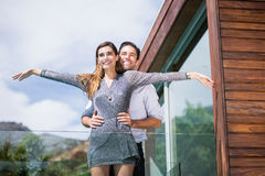 Happy couple posing in balcony Royalty Free Stock Photography