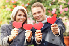 Happy couple posing with hearts Stock Photography