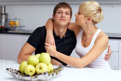 Happy Couple Posing In The Kitchen Royalty Free Stock Images