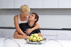 Happy couple posing in the kitchen Stock Images