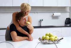 Happy couple posing in the kitchen Royalty Free Stock Image