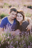 Happy couple posing in a lavender field Royalty Free Stock Photos