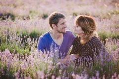 Happy couple posing in a lavender field Stock Image