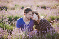 Happy couple posing in a lavender field Stock Photo