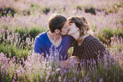 Happy couple posing in a lavender field Royalty Free Stock Photography