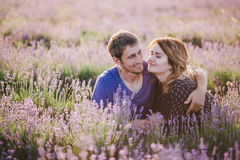 Happy couple posing in a lavender field Royalty Free Stock Photo