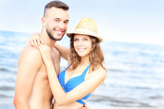 Happy couple posing over the sea Royalty Free Stock Photo